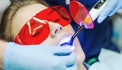Woman receiving in office teeth whitening