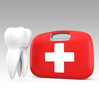Tooth next to a dental emergency kit